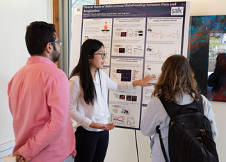Scientist presenting a poster.